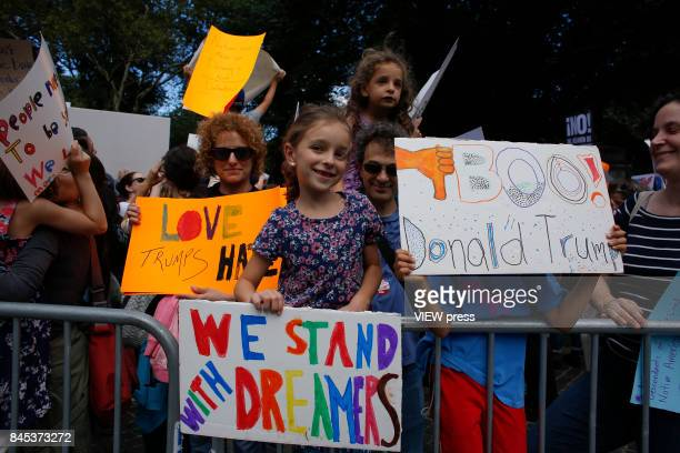 Child holds a placard as she takes part during a march in protest of President Trump's decision on DACA in front of a Trump Hotel on September 9 2017...