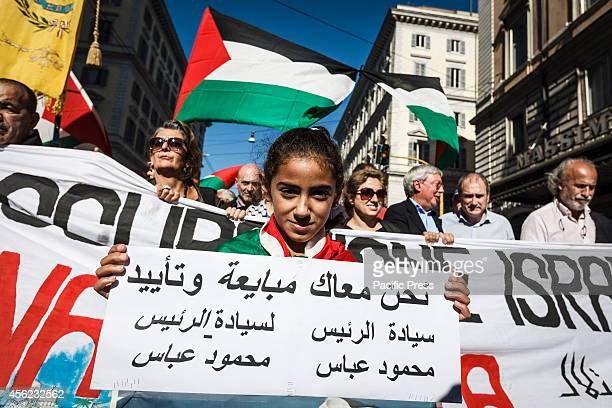 A child holds a placard during a demonstration in Rome to denounce Israel's military campaign in Gaza and to show support to the Palestinian people...