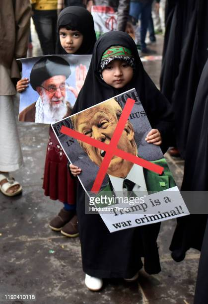 A child holds a placard during a protest against the killing of Iranian major general Qassim Soleimani near US high commission on January 7 2020 in...