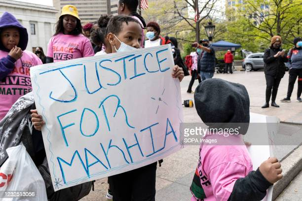 Child holds a placards that says Justice for MaKhia during the demonstration. Black Lives Matter activists gathered in front of the Ohio Statehouse...