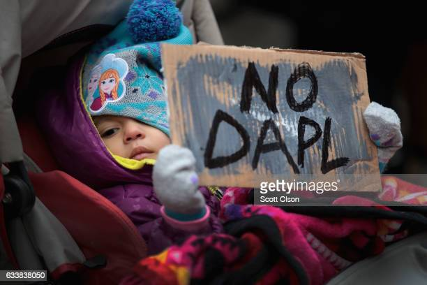 A child holds a sign during a rally protesting the construction of the Dakota Access pipeline on February 4 2017 in Chicago Illinois President Donald...