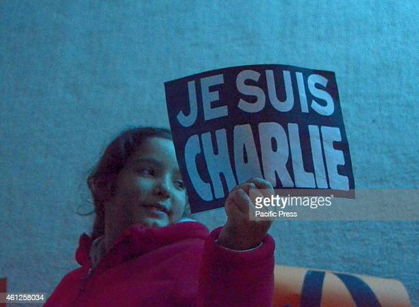 A child holds a sign of solidarityA vigil was organised outside the Institut Français de Grèce in memoriam of the 12 dead after the terrorist attack...