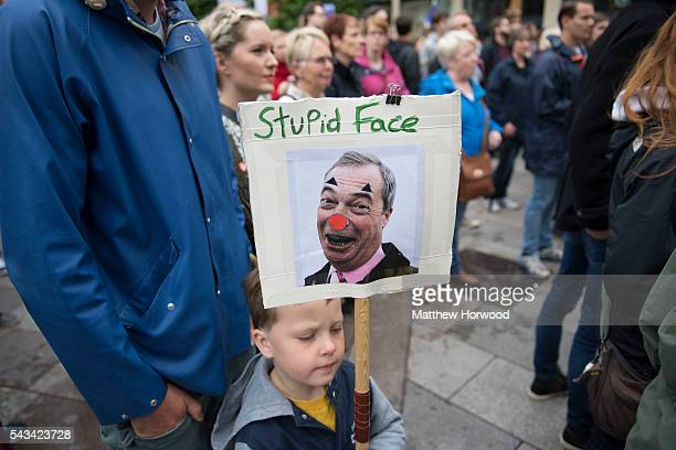 A child holds a sign showing a picture of Nigel Farage leader of UKIP during an antiBrexit rally on June 28 2016 in Cardiff Wales The protest is at a...