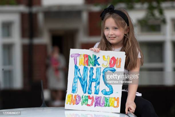 Child holds a sign which says 'Thank you NHS and my mummy' at the Royal Gwent Hospital on April 23, 2020 in Newport, United Kingdom. Following the...