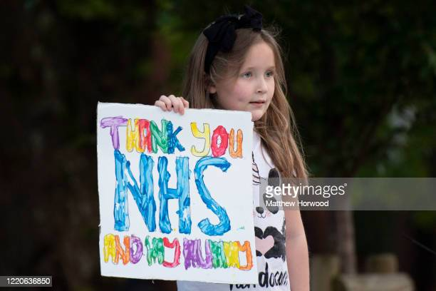 A child holds a sign which says 'Thank you NHS and my mummy' at the Royal Gwent Hospital on April 23 2020 in Newport United Kingdom Following the...
