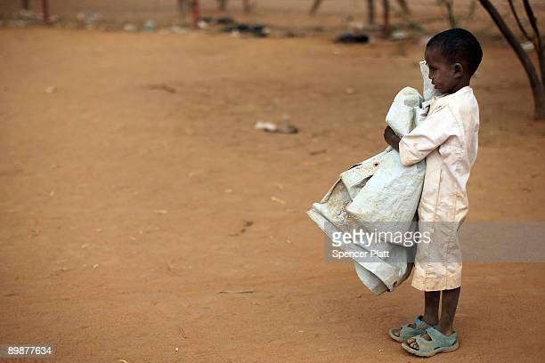 Child holds a tarp in Dadaab, the world�s biggest refugee camp August 19, 2009 in Dadaab, Kenya. The Dadaab refugee complex in northeastern Kenya...
