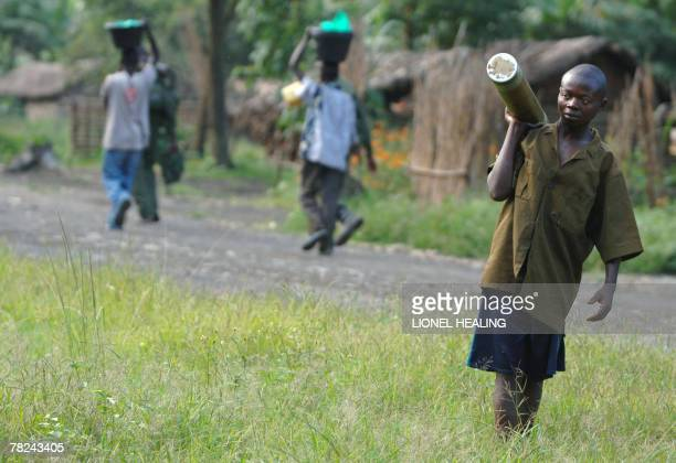 A child holds an artillery shell in a government military position 04 December 2007 near Sake 30km west of Goma Democratic Republic of Congo troops...
