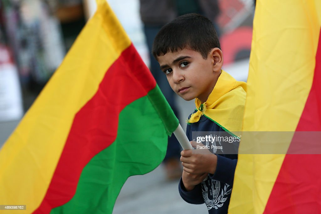 A child holds flag during a protest against the attacks on... : News Photo