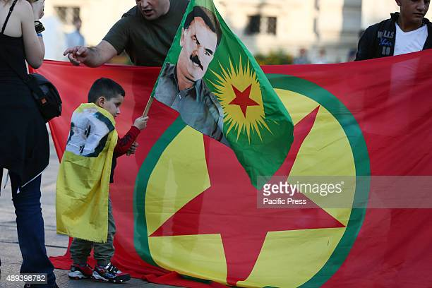 A child holds flag with the face of Abdullah Ocalan a politician guerrilla and revolutionary Turkish nationality Kurdish leader of the PKK currently...
