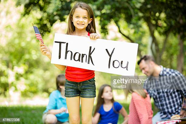 """child holds """"thank you"""" sign with american flag. memorial day. - veterans day stock photos and pictures"""