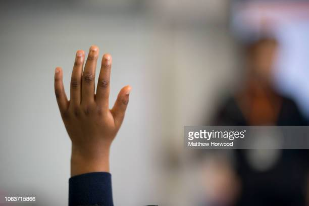 Child holds their hand up in classroom on June 28, 2018 in Cardiff, United Kingdom.