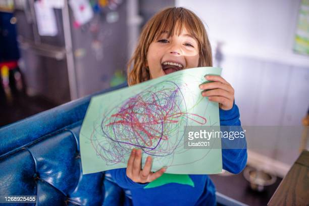 child holds up drawing she made - artistic product stock pictures, royalty-free photos & images