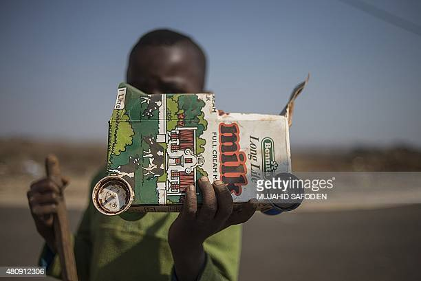 A child holdsup a toy truck he made out of recycled garbage on July 15 in Simunye Children of the Simunye township some 60km away from Johannesburg...