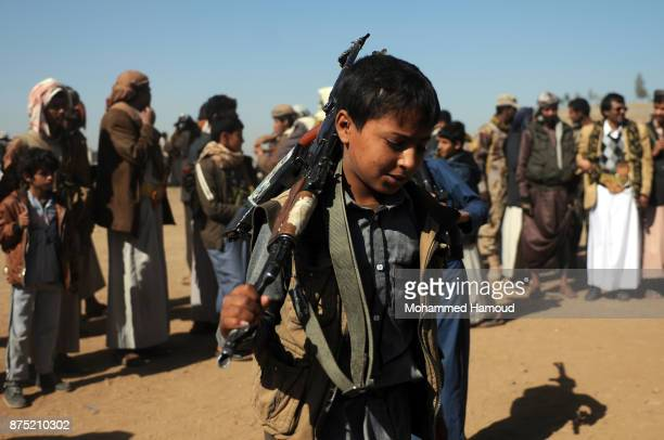 A child Houthi fighter performs the Yemeni traditional Barra dance as part of a tribal gathering staged to reinforce front lines where they are...