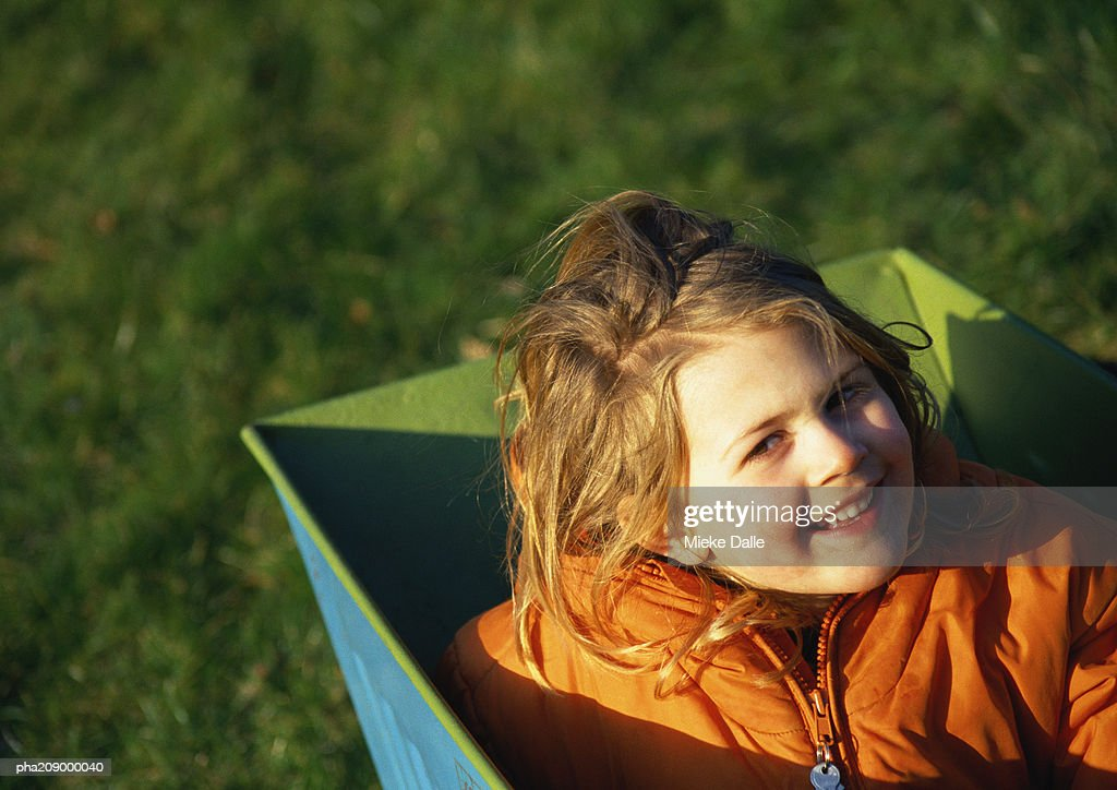 Child in a box, smiling. : Stockfoto