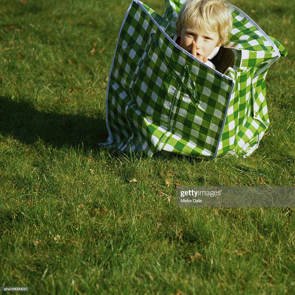 Child in a laundry bag. : Stockfoto