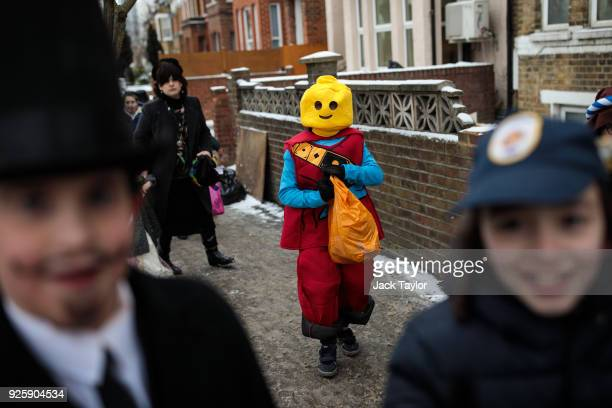 A child in a lego fancy dress costume walks in Stamford Hill during the annual Jewish holiday of Purim on March 1 2018 in London England The annual...