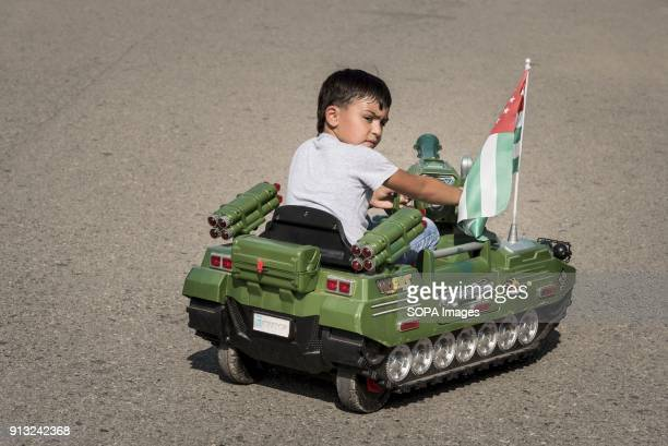 Child in a toy tank on the promenade on the Black Sea coast in Sukhumi Abkhazia is a partially recognized state located in north western Georgia Back...