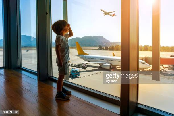 child in airport - airfield stock pictures, royalty-free photos & images