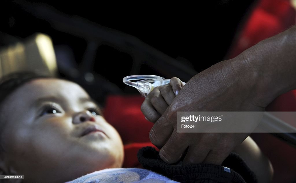 A child in an ambulance on November 19, 2013, in Abuyog, Philippines. Typhoon Haiyan hit the Philippines on November 8, 2013, and was recorded as the second deadliest typhoon in that region. The child, who had a fractured leg, was transported from Rescue SA's field clinic in Abuyog to Baybay hospital.