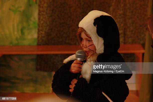 Child In Animal Costume Giving Speech On Stage