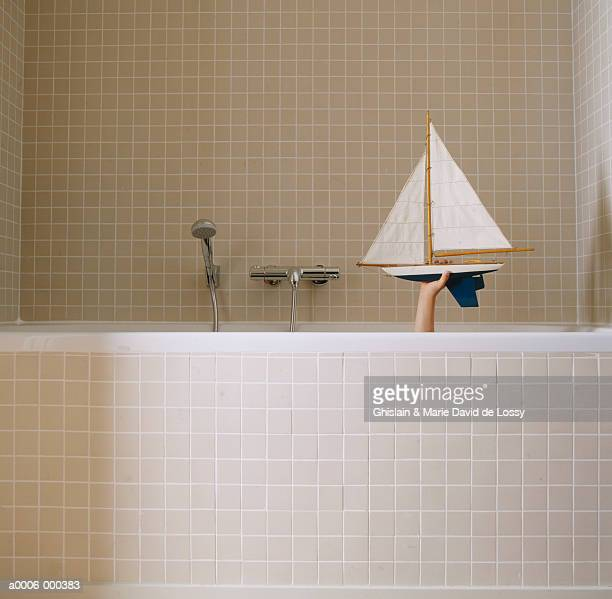 Child in Bath With Toy Boat