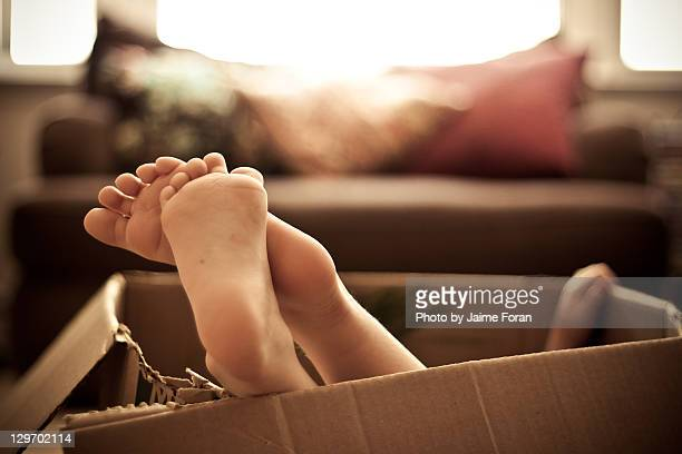 Child in box with feet up