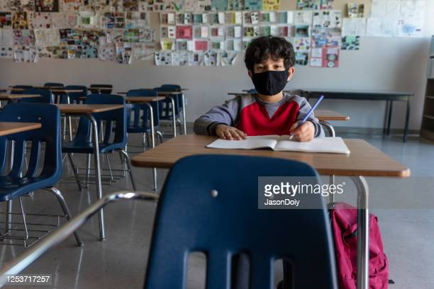 child in classroom coronavirus - one boy only stock pictures, royalty-free photos & images