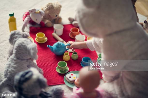 child (4-5) in cozy hooded bear costume, having a teddy bears' picnic - tea party stock pictures, royalty-free photos & images