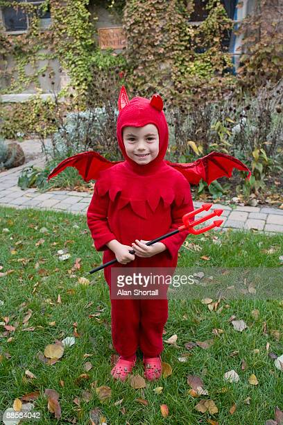 child in devil costume - devil costume stock photos and pictures