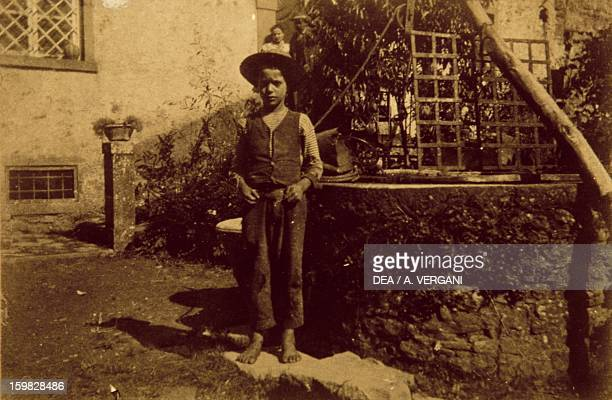 Child in front of the well photograph taken by Giovanni Pascoli Italy 19th century BargaCastelvecchio Pascoli Casa Museo Giovanni Pascoli