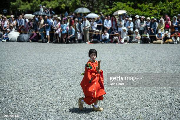A child in Heian period dress takes part in a parade through the grounds of Kyoto Imperial Palace during the Aoi Festival on May 15 2018 in Kyoto...