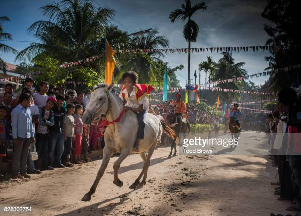 child in horse race at during khmer new year - khmer stock pictures, royalty-free photos & images
