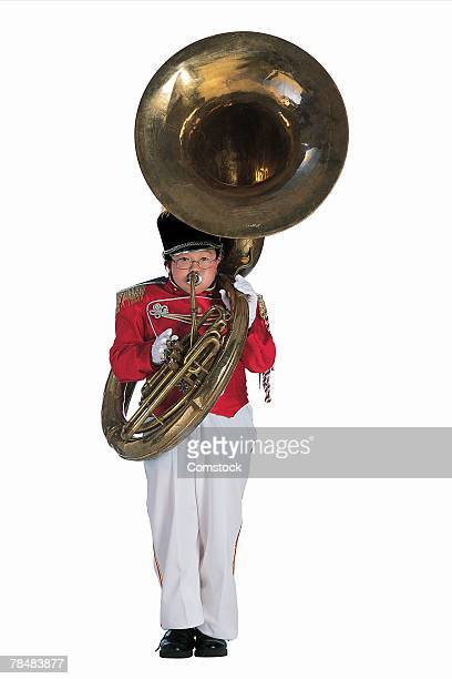 Child in marching band uniform with Sousaphone