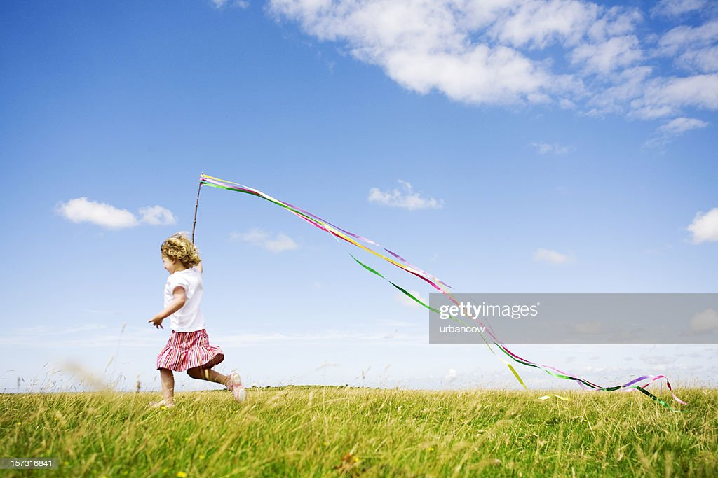 Child in meadow : Stock Photo