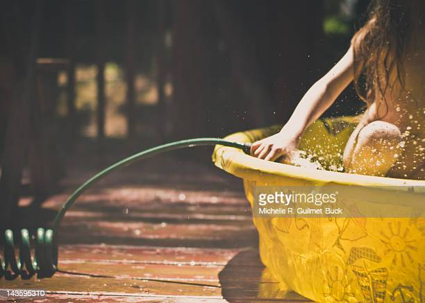 Child in plastic pool