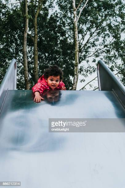child in playground - onebluelight stock pictures, royalty-free photos & images
