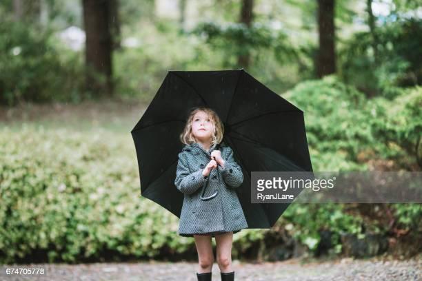 Child in Rain with Umbrella