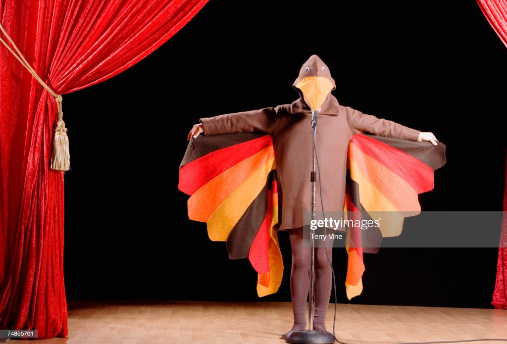Child in turkey costume on stage : Stock Photo