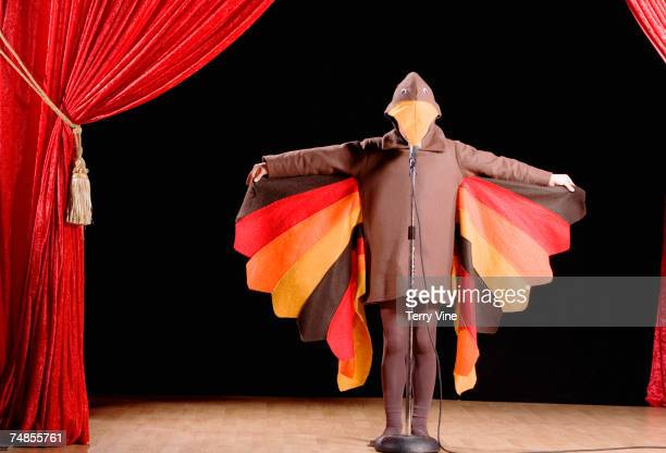 child in turkey costume on stage - turkey bird stock photos and pictures