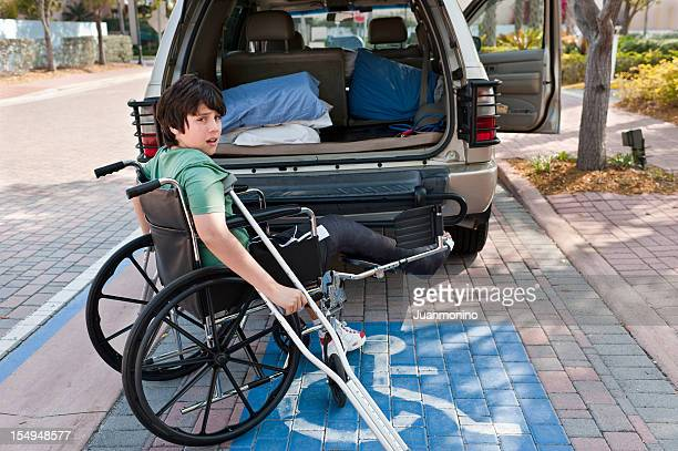 child in wheel chair - disabled sign stock photos and pictures