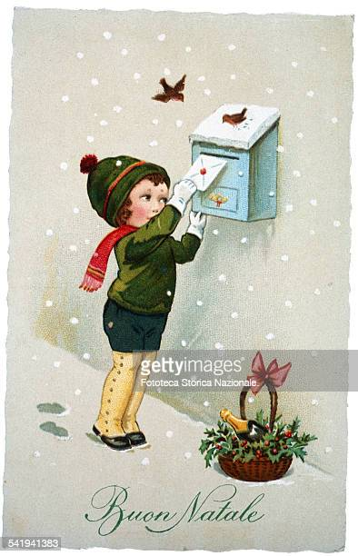 Child in winter clothes dares to confront the snowstorm in order to post his letter to Santa Claus Postcard chromolithography approx Italy 1920
