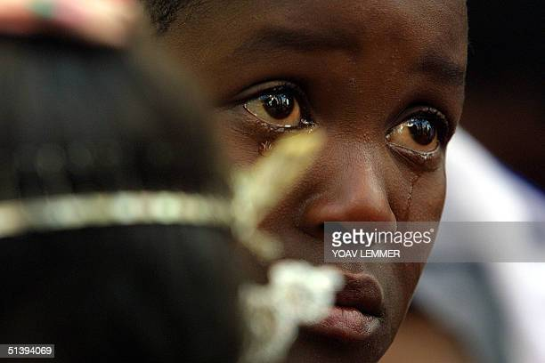 A child infected from the Nkosi Johnson Haven a shelter for HIVpositive mothers and children cries 09 June 2001 during the funeral of Nkosi Johnson...