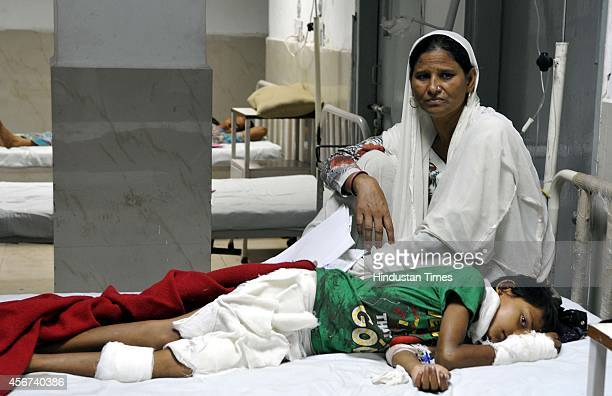 A child injured in firing by Pakistani forces lies on the bed at Government medical college on October 6 2014 in Jammu India At least five civilians...