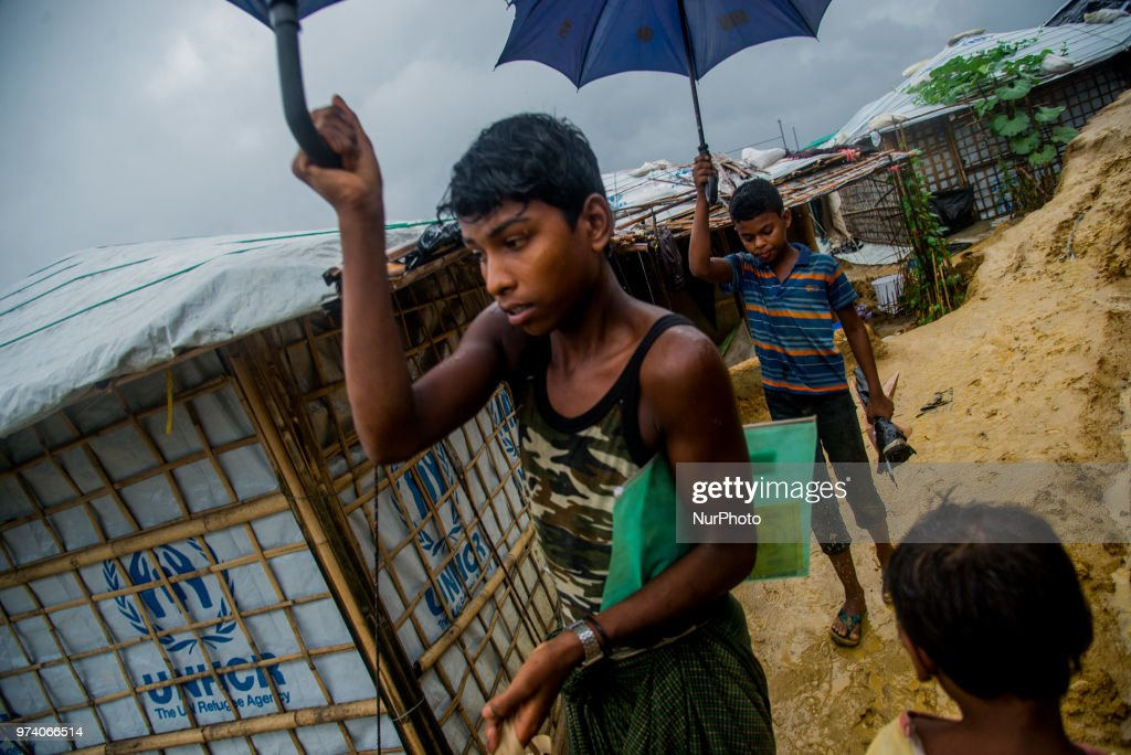 Child inside the Kutupalong makeshift shelter in Coxs Bazar, Bangladesh on June 13, 2018. Around one million Rohingya Refugees has taken shelter on the hills of makeshift shelter in the border side area Cox's Bazar. As the monsoon season has started, the livelihood of rohingya becomes tough even the season becomes threaten for their lives on the hills.