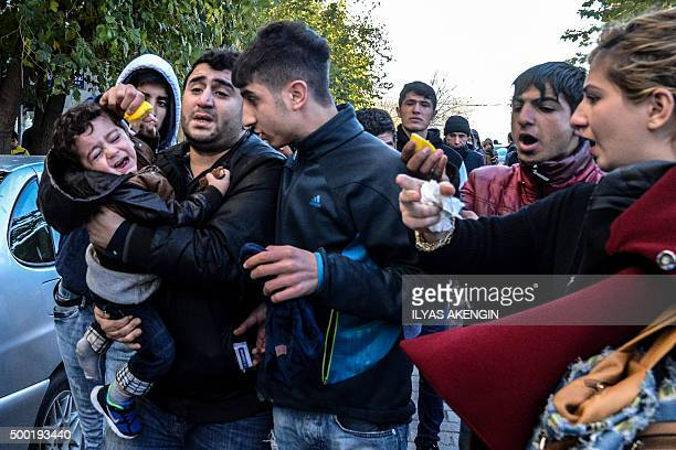 A child is affected by tear gas shot by riot police to disperse protestors from Diyarbakir's historical Sur district which has been placed under a...