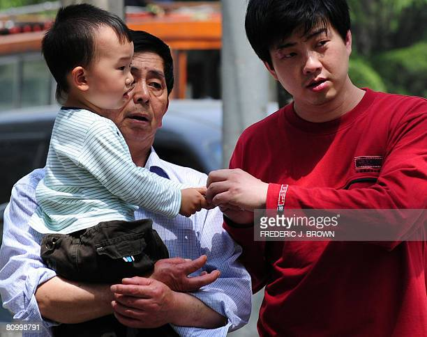 A child is carried to a children's hospital in Beijing on May 6 2008 Ten doctors and officials in China have been punished for mishandling a virus...