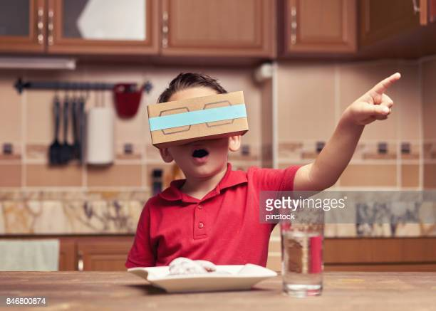 Child is discovering the virtual reality glasses