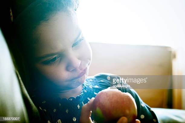 Child (5-6) Is Eating an Apple at Home