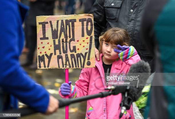 Child is interviewed with her dad during the anti-lockdown protest on November 14, 2020 in Bristol, England. Police had warned protesters to cancel...